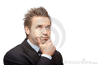 Contemplative Businessman thinks on problem