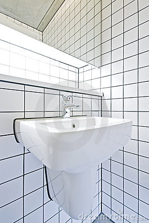 Contemporary bathroom detail with retro tiled wall