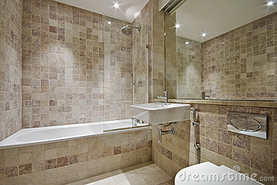Contemporary bathroom with natural stone tiles
