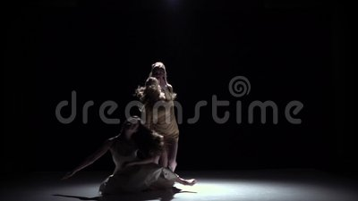 Contemporary dance performance of five girls in white dresses, on black, shadow, slow motion. Contemporary dance performance of five talanted girls in white stock video footage