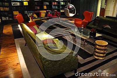 Contemporary interior red armchair,green sofa