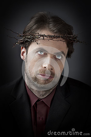 Man in a crown of thorns - unhappy office worker concept