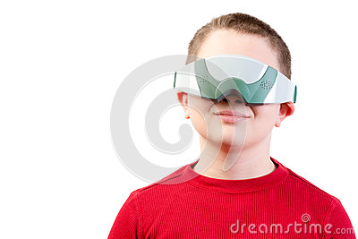 Content boy in red wears virtual reality glasses Stock Photo