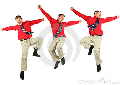 Contented dynamic jumping businessman in red shirt