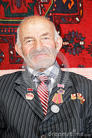 Contented senior man with medals