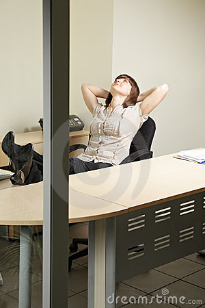 Contented woman in office