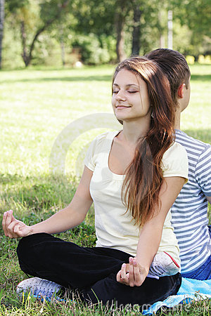 Contented woman relaxing in yoga pose