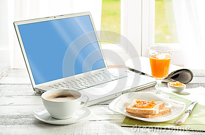 Continental breakfast and laptop computer