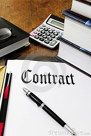 Contract and calculator on a desk