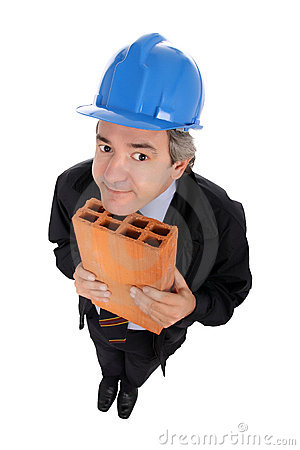 Contractor with hard hat and brick
