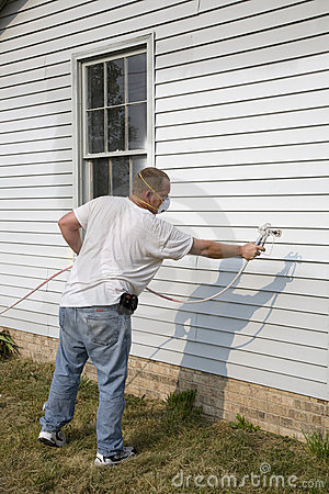 Contractor spray painting
