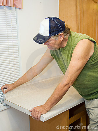 Contractor Working with Laminate