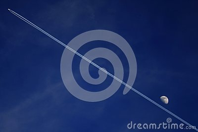 Contrail of jet and moon