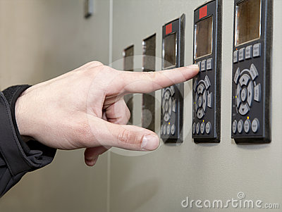 Control panel and hand at work