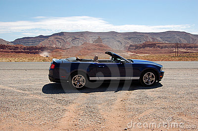 Convertible sport car in Utah desert