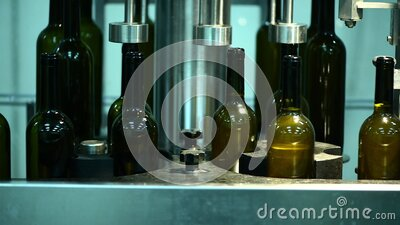 Conveyor with wine bottles at wine factory, white wine bottling, wine stopper stock video footage
