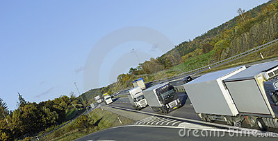Convoy of trucks on highway
