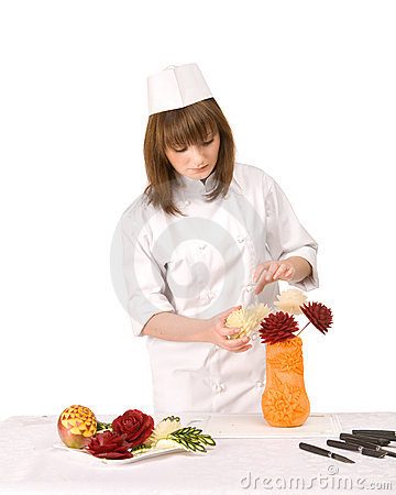 Cook girl decorates a vase