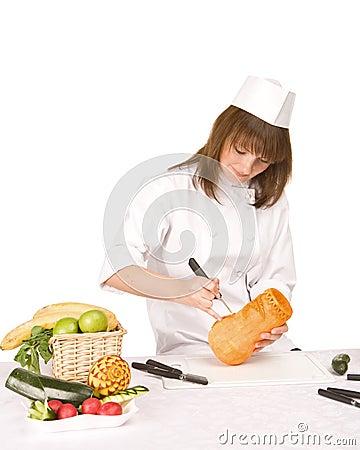 Cook girl makes carving a pumpkin vase