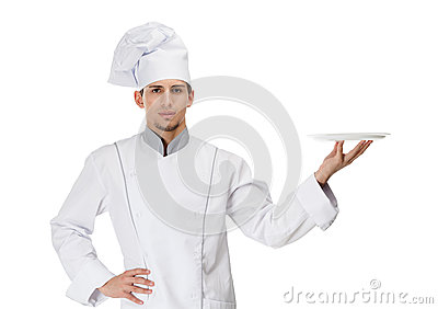 Cook handing a white plate