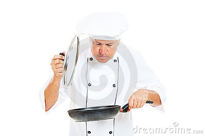 Cook holding frying pan and cover