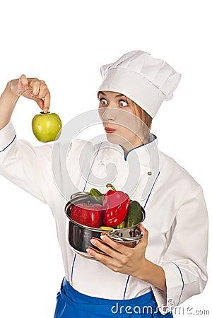 Cook holds pepper. studio