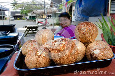 Cook Islander woman sale fresh coconuts Editorial Image