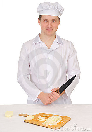 Cook with knife and preparation board