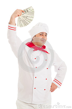 Cook man holding fan of dollars wearing white uniform