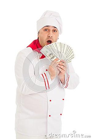 Cook man holding fan of dollars wearing white uniform
