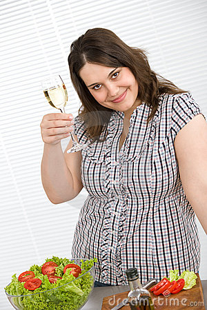 Cook - Plus size happy woman with white wine