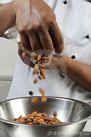 Cook preparing a recipe with almonds