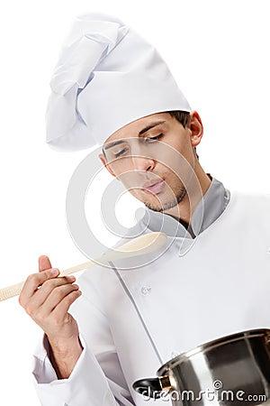 Cook tastes the prepared dish