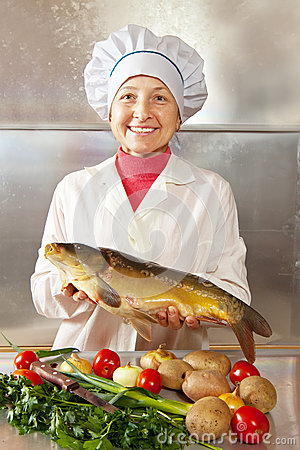 Cook woman with carp
