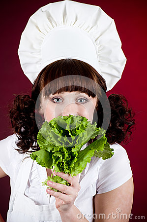 cook woman with green salad
