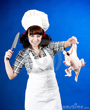 Cook woman holds a Crude hen and knife