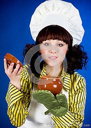 Cook woman holds a hot pot