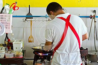 Cook at work in Thai restaurant Editorial Photo