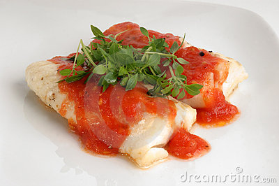 Cooked cod loins with tomato sauce