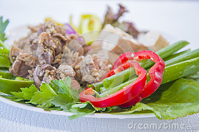 Cooked lamb giblets with vegetables. Stock Photo