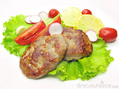 Cooked meat cutlets with vegetables