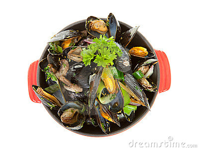 Cooked mussels in red casserole