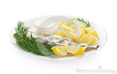 Cooked potatoes with herring and sauce