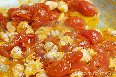 Cooked red cherry tomatoe and shrimps