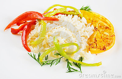 Cooked rice with fried orange and pepper slices