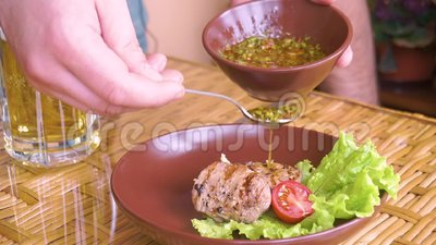Cooked tenderloin steak with chimichuri on the plate. Tracking shot stock video footage