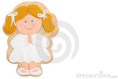 Cookie blonde girl first communion Stock Photo
