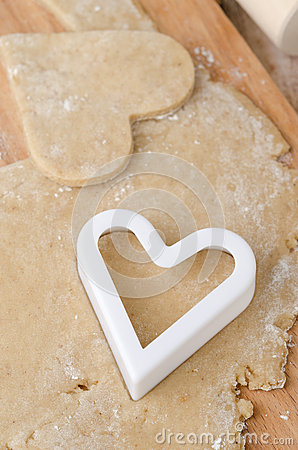 Cookie cutters in the form of heart in cookie dough