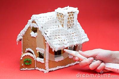 Cookie house on red background decorating Stock Photo