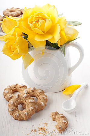Cookie and yellow rose